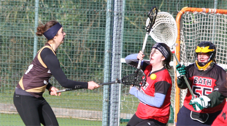 Abi Chell stands up to a shot from Helen Murray